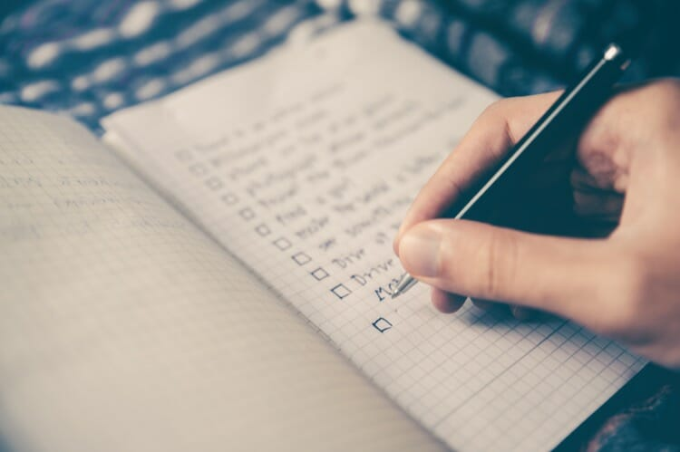 A person making SEO checklist which should be fulfilled by WordPress Theme